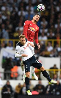Manchester United's Chris Smalling in action with Tottenham's Christian Eriksen
