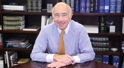 George Muzinich who founded the firm in 1988