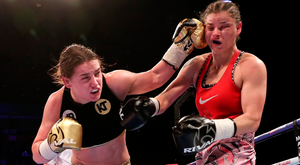 Katie Taylor lands a punch on Milena Koleva during their fight
