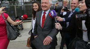 Sean FitzPatrick leaves Dublin Circuit Criminal Court with his daughter Sarah after he was acquitted on all charges