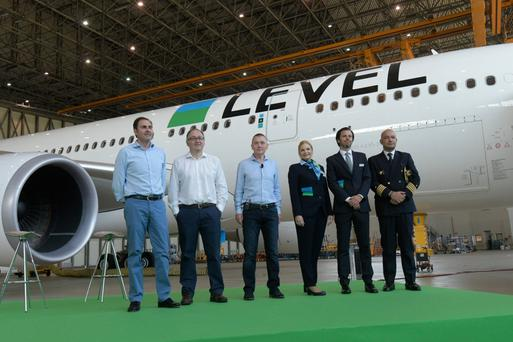 IAG boss Willie Walsh with airline staff from the new transatlantic operator Level