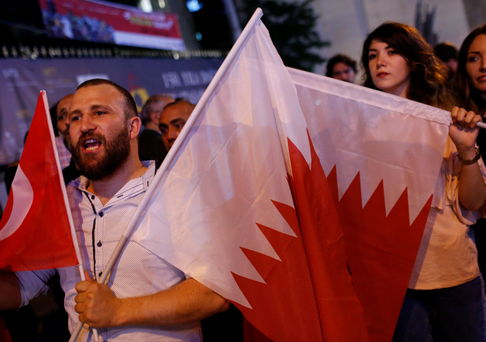 People shout slogans as they hold Turkish and Qatari flags during a demonstration in favour of Qatar in central Istanbul. Photo: Reuters
