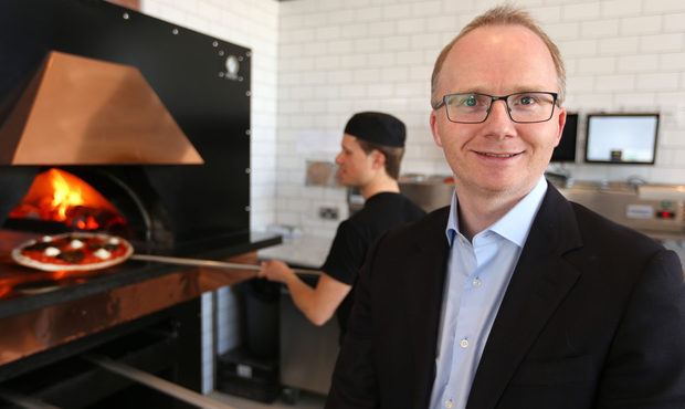 Shane Crilly, who founded Base Wood-fired Pizza in 2008, in his Glenageary shop — one of five stores in Dublin. Photo: Gerry Mooney