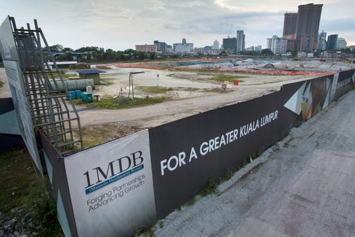 Signage for 1Malaysia Development Bhd (1MDB) is displayed at the site of a project in Kuala Lumpur, Malaysia