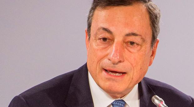 U.S. dollar falls on Draghi's comments