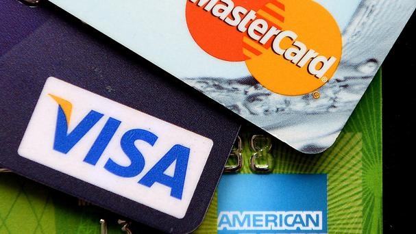Consumers will no longer have to pay surcharges for using credit cards from the start of next year. Stock Image