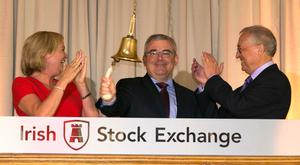 CEO Bernard Byrne, centre, with Deirdre Somers, CEO, Irish Stock Exchange, and AIB chairman Richard Pym, at its IPO