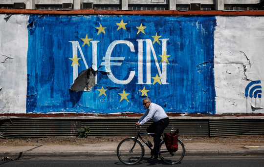 Anti-EU slogans in Athens at the height of the financial crisis. The country remains split about how the economy is faring. Photo: Bloomberg