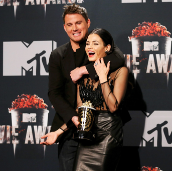 Actor Channing Tatum and wife Jenna Dewan pose with his award at the MTV Movie Awards. MTV parent Viacom predicts a 3pc fall in subscribers