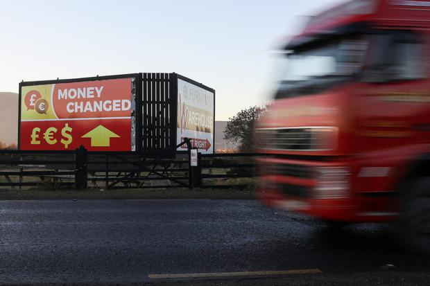 A currency exchange sign on the border near Newry. Irish exporters will be hit if sterling continues on its downward trajectory Photo: Bloomberg