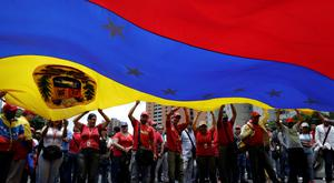 Pro-government supporters holding a Venezuela's flag attend a rally against US President Donald Trump in Caracas, Venezuela