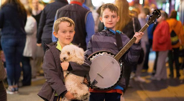 Cathal Fitzgerald, from Tralee, Co Kerry, with 'Bobby' and Darragh Claffey, from Dublin, at the Fleadh Cheoil na hÉireann in Ennis, Co Clare. Photo: Eamon Ward