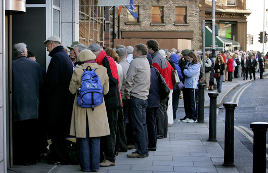 Northern Rock customers who feared for their savings queue up to withdraw cash at the beginning of the credit crunch in 2007