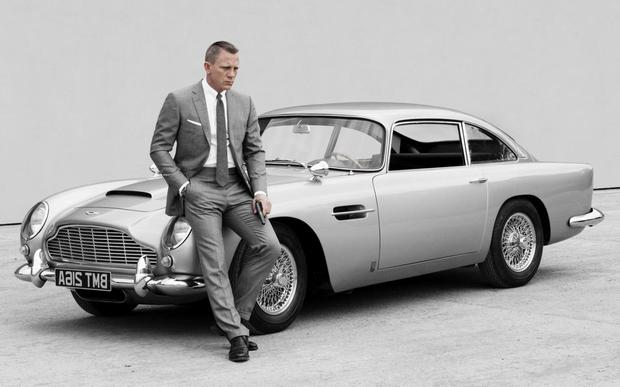 James Bond's Daniel Craig in front of a vintage Aston Martin DB5