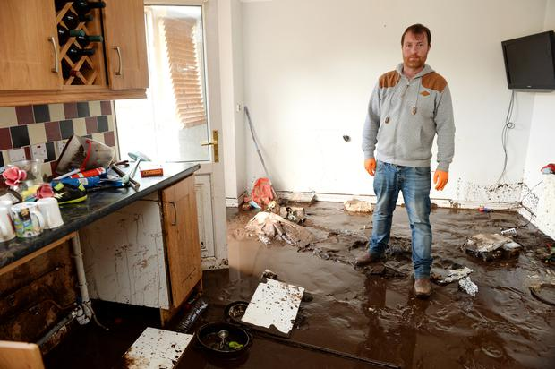 Gerard Gallagher in his flood and sewage-damaged home in Burnfoot, Donegal as three counties in the north-west were hit by floods. Photo: Caroline Quinn