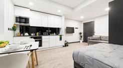 A studio apartment's kitchen, bedroom and dining space in Uninest New Mill, situated in Dublin. Prices start at €980