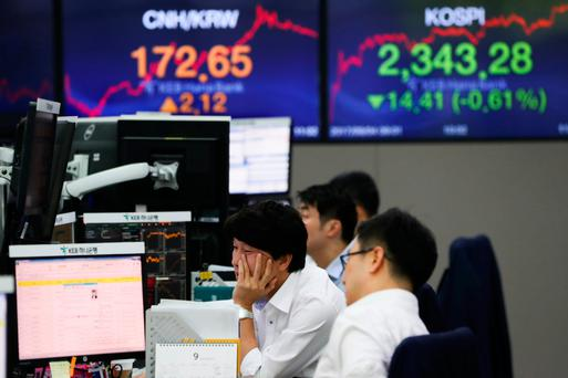 Foreign currency dealers work in a dealing room of KEB Hana Bank in Seoul, South Korea