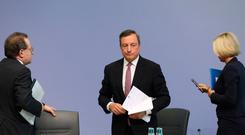 Mario Draghi, president of the European Central Bank (ECB), stands as he departs a news conference following the bank's interest rate decision, at the ECB headquarters in Frankfur