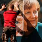 A worker pastes up a campaign poster for Angel Merkel's CDU party in Berlin. Photo: Reuters