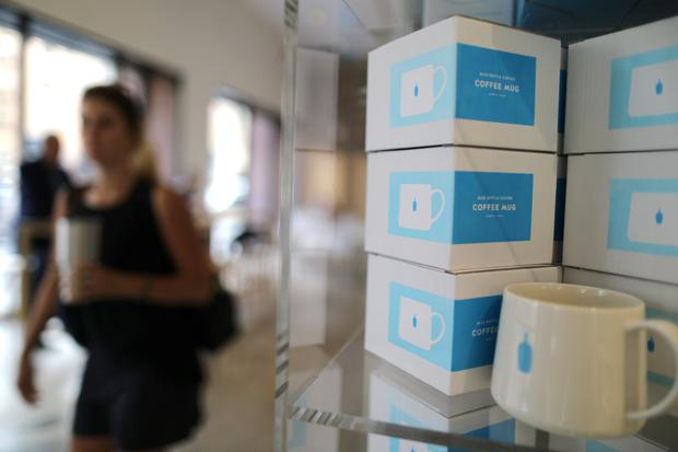 A Blue Bottle coffee shop is seen in Los Angeles, California. Nestlé plans to acquire a 68pc stake in Blue Bottle Coffee in a deal estimated at $500m (€418m) Pic: Reuters