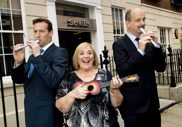Savills director Gavin Butler, Mary Byrne and Savills chairman Roland O'Connell, at the launch