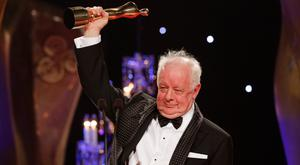 Jim Sheridan receiving the Lifetime Achievement Award at the IFTA Awards in 2015 – his firm Chartscript has seen a jump in accumulated profits. Photo: Kyran O'Brien