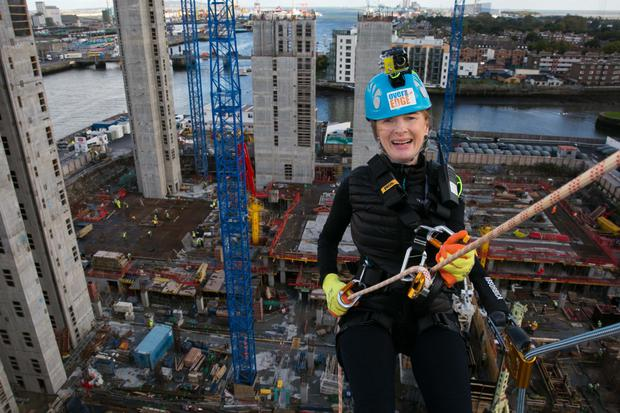 State Street executive Susan Dargan abseils from the company's Irish offices in Dublin in a charity event last year