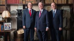 Portwest founder Owen Hughes, Cathal Hughes, and Harry Hughes in Westport House