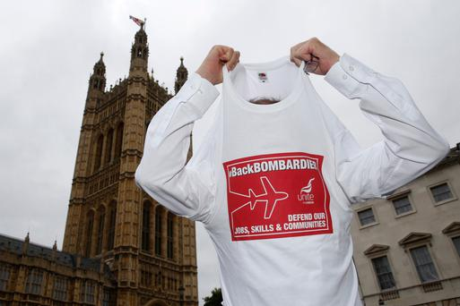 A demonstrator in support of Bombardier workers at the UK's Houses of Parliament