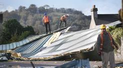 The roof of Douglas Community School in Cork was blown off as Hurricane Ophelia caused massive damage. Photo: Mark Condren