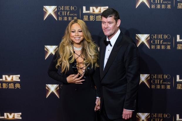 James Packer, co-chairman of Melco Crown Entertainment, with singer Mariah Carey at a red carpet event prior to the opening ceremony of Studio City casino resort in Macau, China. Picture: Bloomberg