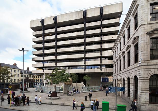 Construction company John Paul is currently removing its scaffolding and hoarding from the Central Bank plaza site on Dublin's Dame Street
