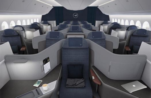 The wider business class seat (foreground) and longer seats behind in the new-look class.