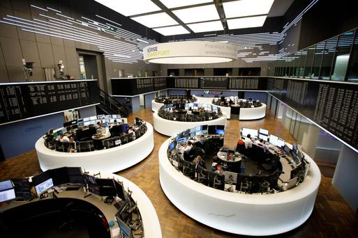 Traders monitoring data at the Frankfurt Stock Exchange yesterday as MiFiD II came into force. Photo: Alex Kraus/Bloomberg