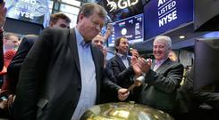 Ardagh boss Paul Coulson rings the bell at the New York Stock Exchange to mark its IPO in March. He has built the firm into a global player and has now put together an extraordinary deal with payment-in-kind notes. Photo: AP
