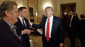 Huge riches: US President Donald Trump greets multi-billionaire Elon Musk with former advisor Steve Bannon. Photo: Getty
