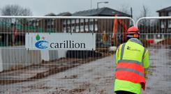 Workers have downed tools and walked off Carillion sites following the collapse of the British building giant. Photo: PA
