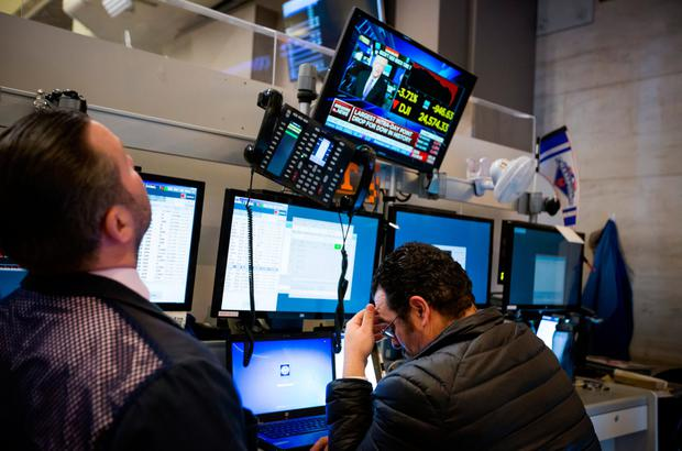 Traders react on Wall Street during the week in a slump which occurred almost out of the blue, confounding analysts. Photo: Bloomberg