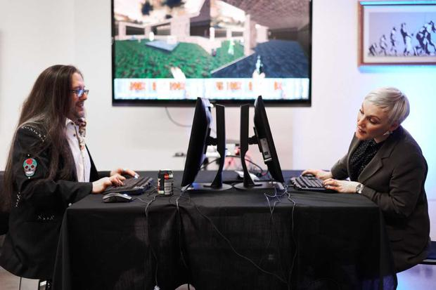 Hundreds attended 404 London this weekend, an event aimed at enticing top tech talent from the UK to Ireland. Pictured at the event in Shoreditch, London, was Jackie Slattery, co-founder of 404, challenging John Romero of Romero Games at 'Doom', the legendary computer game he created. Photo: Doruk Yemenici.