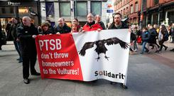 Solidarity TDs and activists hold a protest in opposition to the mortgage book sale outside the Grafton Street branch of Permanent TSB. Photo: PA