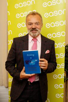 Best-sellers by TV star Graham Norton (pictured) and rugby legend Paul O'Connell helped drive profits at Waterstones. Photo: Andres Poveda Photography Ltd
