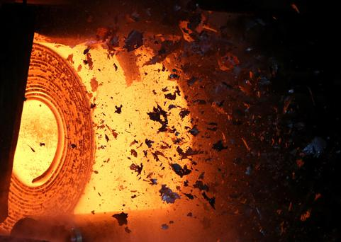 Scale flies off of a steel coil as it is unrolled on the line at the Novolipetsk Steel PAO steel mill in Farrell, Pennsylvania – US president Donald Trump, inset below, has said his tariffs will protect the US steel industry