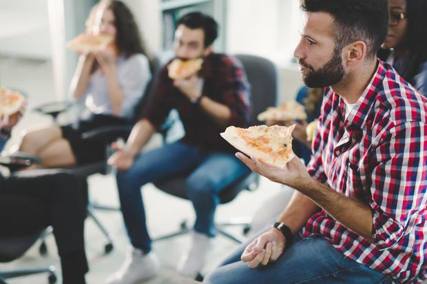 It is much easier to chat to people in a casual setting over beer and pizza than at a stuffy official networking event. Stock image
