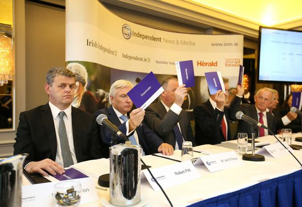 Robert Pitt, the then chief executive of Independent News and Media, abstains from voting for the re-election of INM chairman Leslie Buckley during the company's AGM in the Westbury Hotel in Dublin last year