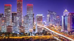 Surging home sales in Beijing and elsewhere have driven valuations of China's listed property firms