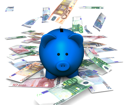A funny piggybank or money-box with falling money (euro)