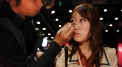 A woman having Shiseido makeup applied in a store in Tokyo
