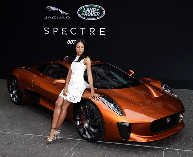Bond star Naomie Harris with the Spectre Jaguar stunt car which Mike Keane worked on before moving to Fintos Electric cars. Photo: Getty Images