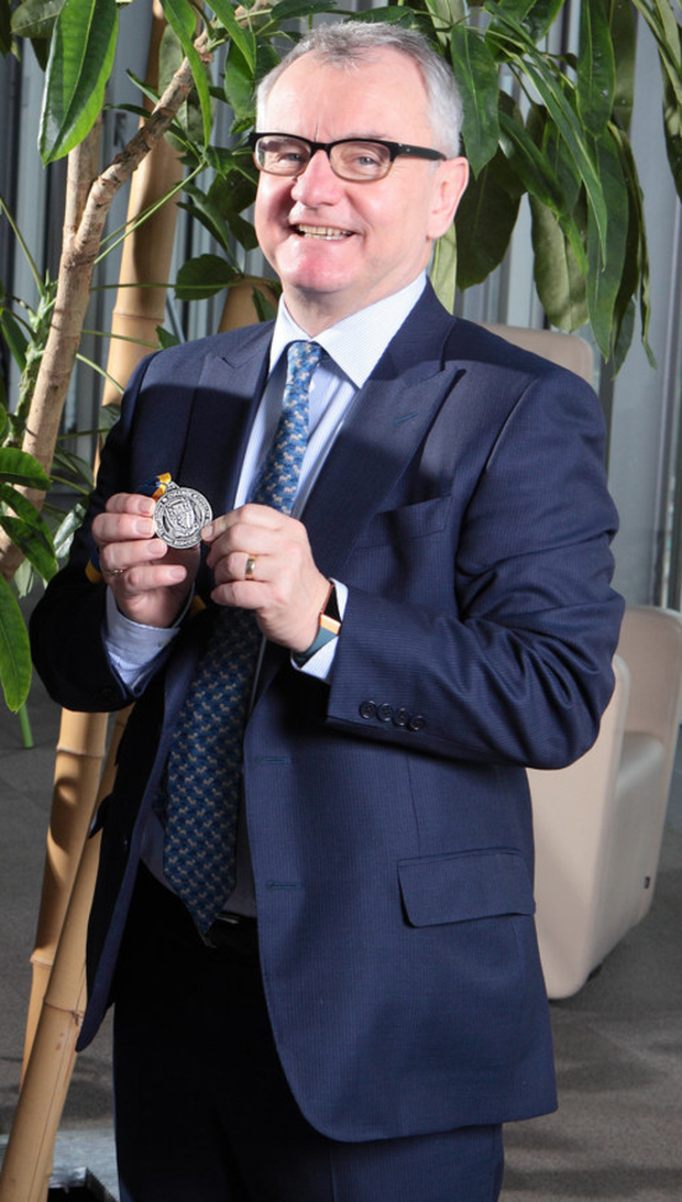 Michael Cullen with the medal he received after getting the UCD Smurfit School Alumnus of the Year award