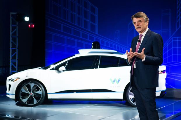 Ralf Speth, CEO of Jaguar Land Rover, speaks while standing in front of the Jaguar I-Pace with Waymo autonomous electric vehicle at an event in New York. Photo: Bloomberg